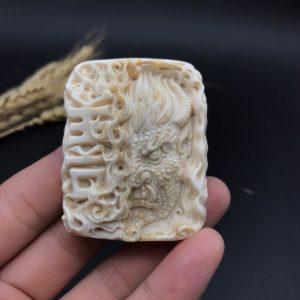 猛犸象牙两面雕刻牙髓一念之间牌子